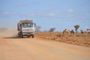 Tipper truck transporting material for rehabilitation works